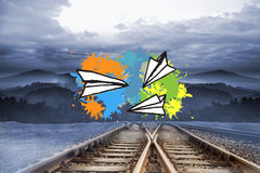 Composite image of paper airplanes on paint splashes Royalty Free Stock Photo