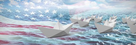 Composite image of paper boats made of origami. Paper boats made of origami against idyllic view of sea Royalty Free Stock Photography