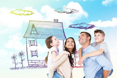 Composite image of parents giving piggyback ride to children while looking up. Parents giving piggyback ride to children while looking up against blue sky Royalty Free Stock Photography