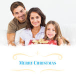 Composite image of parents offering a gift to their daughter Royalty Free Stock Photos