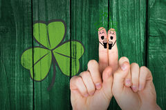 Composite image of patricks day fingers Stock Image