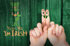 Composite image of patricks day fingers Royalty Free Stock Photo
