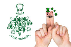 Composite image of patricks day fingers Stock Photo