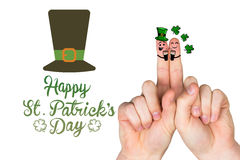 Composite image of patricks day fingers Royalty Free Stock Photos
