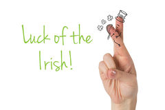 Composite image of patricks day fingers Stock Images