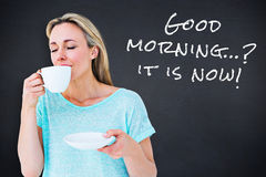 Composite image of peaceful blonde drinking hot beverage with eyes closed Royalty Free Stock Photo