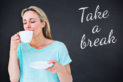 Composite image of peaceful blonde drinking hot beverage with eyes closed Stock Photos