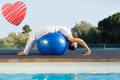 Composite image of peaceful brunette in cobra pose over exercise ball poolside Stock Image