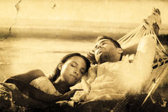 Composite image of peaceful couple napping in a hammock Stock Images