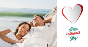 Composite image of peaceful couple napping in a hammock Royalty Free Stock Images