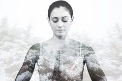 Composite image of peaceful woman in white sitting in lotus pose royalty free stock images