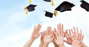 Composite image of people raising hands in the air Royalty Free Stock Photo