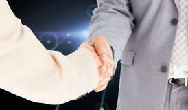 Composite image of people in suit shaking hands Royalty Free Stock Photo