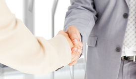 Composite image of people in suit shaking hands Stock Image