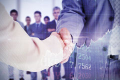 Composite image of people in suit shaking hands Stock Photo