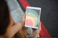 Composite image of pie chart. Pie chart against cropped hands of man holding tablet stock images