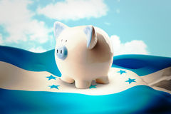 Composite image of piggy bank Stock Image
