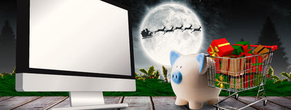 Composite image of piggy bank Stock Photos
