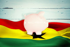 Composite image of piggy bank Stock Photography