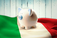 Composite image of piggy bank Stock Photos