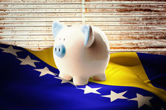Composite image of piggy bank Royalty Free Stock Photos