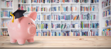 Composite image of piggy bank with graduation hat vector illustration