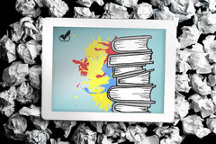 Composite image of pile of books on paint splashes Stock Image