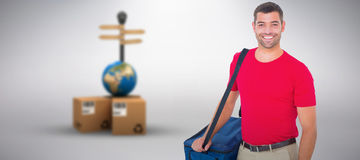Composite image of pizza delivery man holding bag. Pizza delivery man holding bag against grey background royalty free stock images