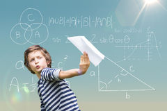 Composite image of playful boy holding paper airplane royalty free stock photos