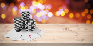 Composite image of playing cards with black casino tokens Stock Photos