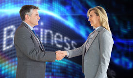 Composite image of pleased businessman shaking the hand of content businesswoman Stock Photo