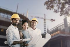 Composite image of portrait of architects blueprint Stock Image