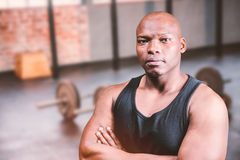 Composite image of portrait of bald bodybuilder with arms crossed Stock Images