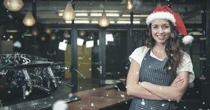 Composite image of portrait of barista wearing santa hat Stock Photo
