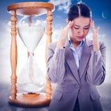 Composite image of portrait of a beautiful businesswoman having a headache Stock Photo