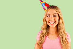 Composite image of portrait of a beautiful woman with party hat Stock Images