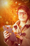 Composite image of portrait of beautiful woman using tablet pc Royalty Free Stock Photography