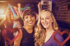 Composite image of portrait of beautiful women standing together in bar Stock Photos