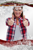 Composite image of portrait of a blissful woman with the thumbs up Stock Photo