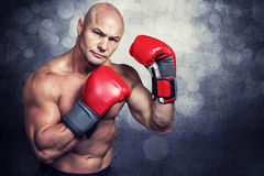 Composite image of portrait of boxer with red gloves Stock Photo