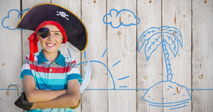 Composite image of portrait of boy pretending to be a pirate Royalty Free Stock Photo