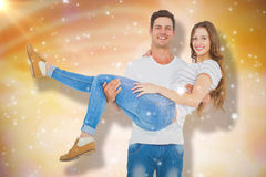 Composite image of portrait of boyfriend carrying girlfriend Stock Photos