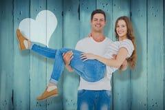 Composite image of portrait of boyfriend carrying girlfriend Stock Photo
