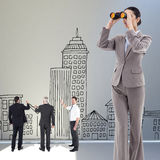 Composite image of portrait of a brunette businesswoman looking through binoculars Stock Images