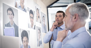 Composite image of portrait of business people. Portrait of business people  against businessman with hand on chin Royalty Free Stock Images