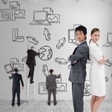 Composite image of portrait of business people standing back-to-back Royalty Free Stock Images