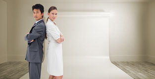 Composite image of portrait of business people standing back-to-back Royalty Free Stock Photos