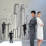 Composite image of portrait of business people standing back-to-back Royalty Free Stock Image
