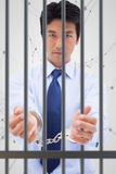 Composite image of portrait of a businessman with handcuffs Royalty Free Stock Photo