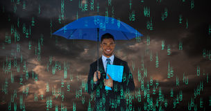 Composite image of portrait of businessman holding blue umbrella and file. Portrait of businessman holding blue umbrella and file against blue and orange sky Royalty Free Stock Photography